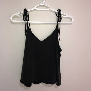 Blouse with tie bow straps in new condition